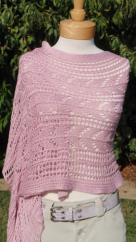 A pretty shawl created by modifying an existing afghan pattern.